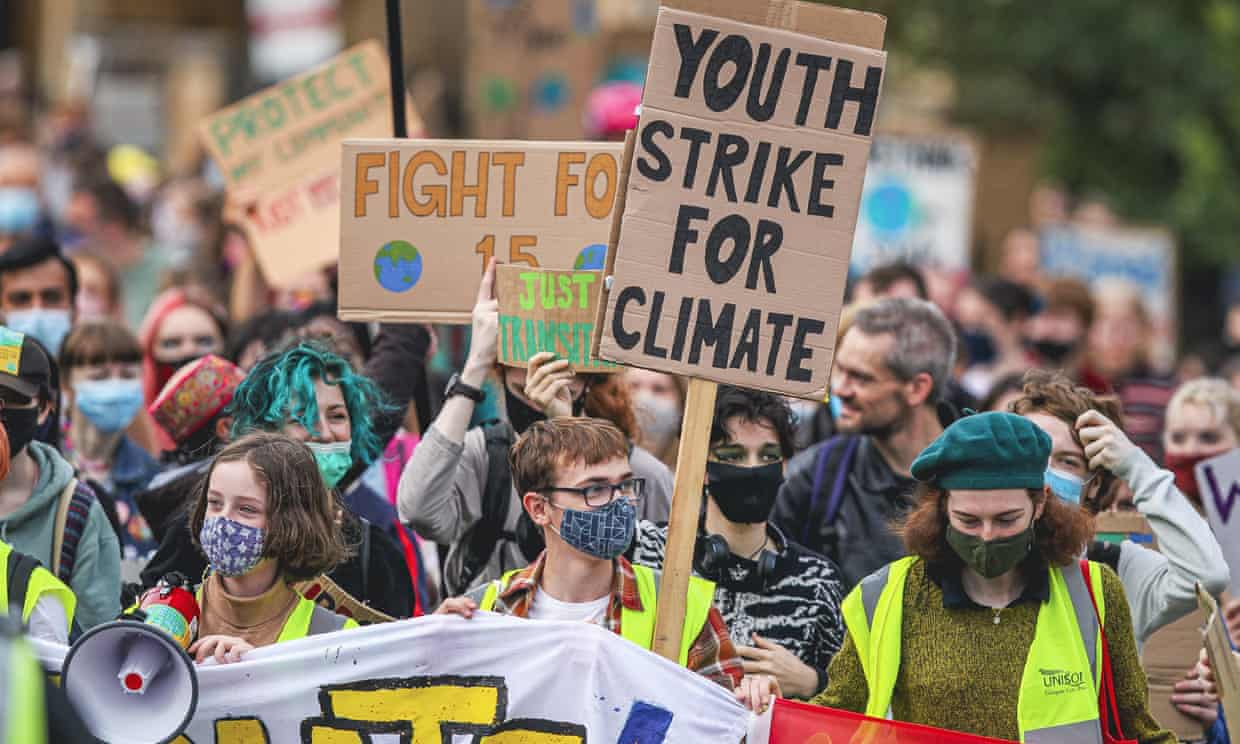 Protesters take part in a climate protest in Glasgow as part of the Global Youth Strike For Climate in the lead up to COP26 climate summit in the city. Photograph: Ewan Bootman/NurPhoto/Rex/Shutterstock