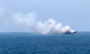 Smoke is seen billowing from a naval vessel off the coast of Rafa in the Gaza Strip.
