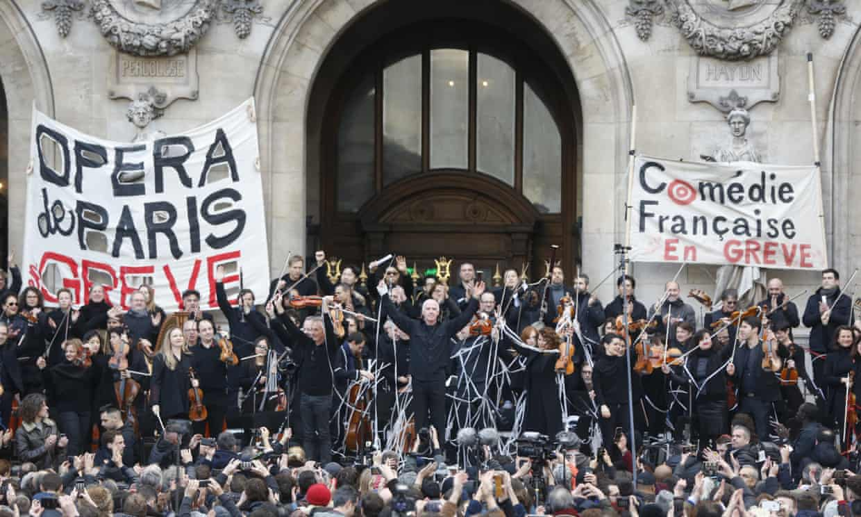 Striking opera musicians wave to the crowd after performing outside the Palais Garnier opera house. Photograph: Thibault Camus/AP