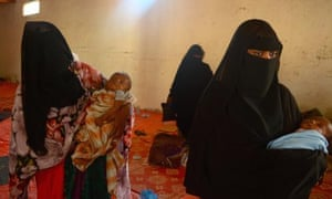 Yemeni refugees in Somalialand. Two women waiting to be transported to Hargeisa at a compound in Berbera where they spent the night after arriving from Yemen.