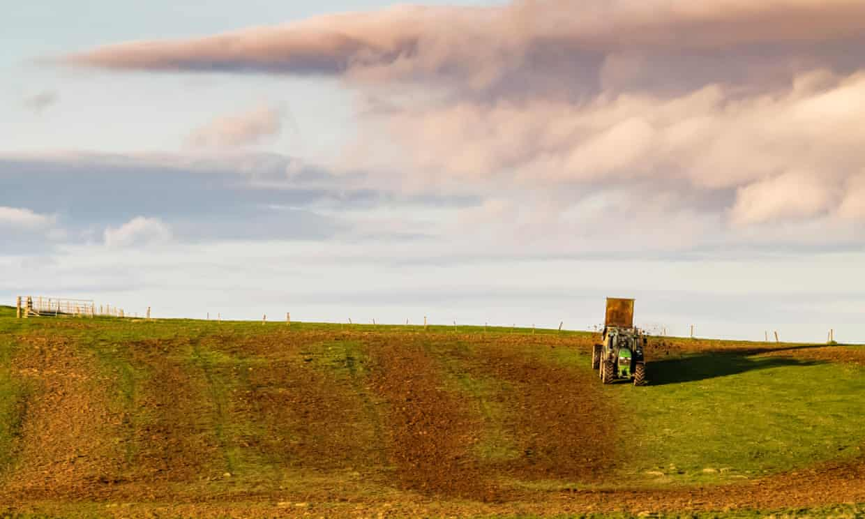 A farmer spreads manure over a field in the Scottish Borders. Cutting emissions from agriculture – including ammonia from manure and fertilisers, has proved a challenge. Photograph: Chris Strickland/Alamy Stock Photo