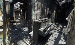 A destroyed piano is part of the charred remains of Briar Creek Road Baptist Church in North Carolina on 24 June 2015. The Charlotte Fire Department says the fire at the predominantly black church was arson.
