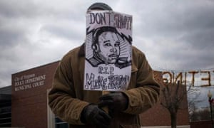 A protester holds an image of Michael Brown in Ferguson.