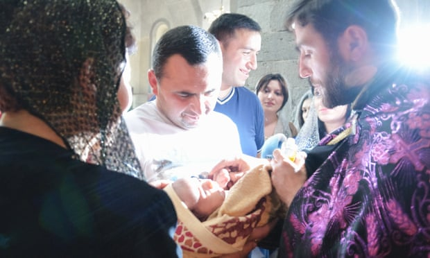 A baby is baptised in the Armenian Apostolic church in Goris, Armenia. Critics say the new law fails to address the poverty and patriarchal values causing the gender imbalance. Photograph: Alamy Stock Photo