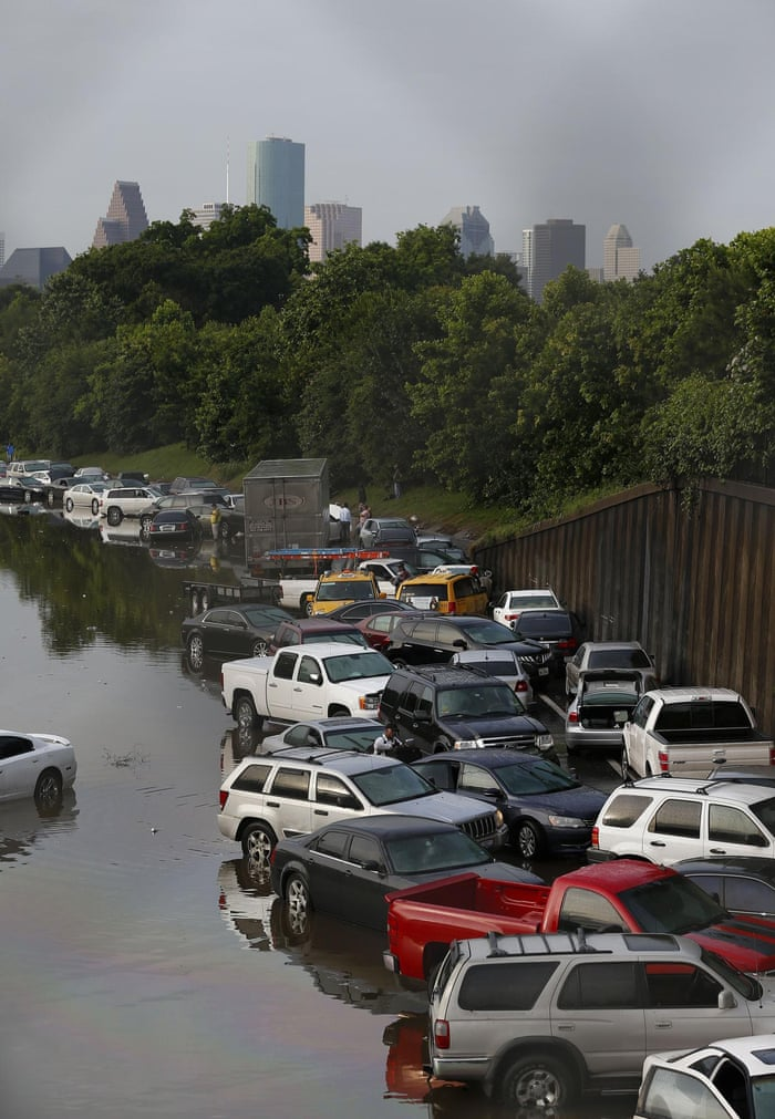 Vehicles are left stranded on a flooded Interstate 45 in Houston, Texas on 26 May.,