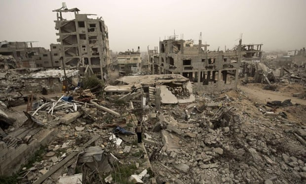 A Palestinian child stands amid the rubble of buildings destroyed during Operation Protective Edge in Gaza City's Shejaiya neighbourhood.
