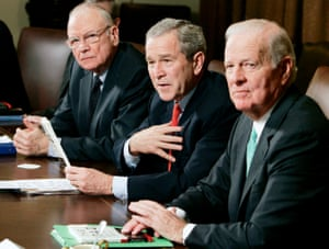 George W Bush, with Lee Hamilton on the left, speaks to the press after receiving a report of the Iraq study group.