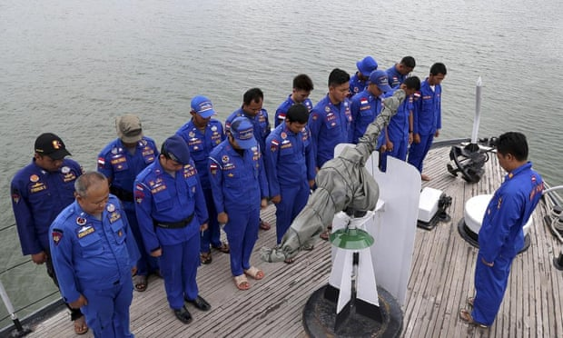 Missing AirAsia flight: search area set to expand as families.