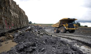 A Caterpillar Inc. truck moves across a mine