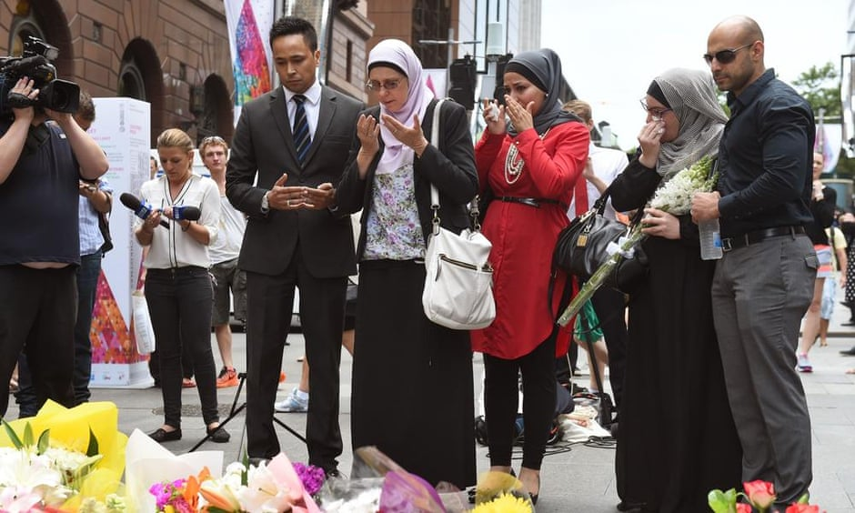 Muslims pray after laying flowers in Martin Place