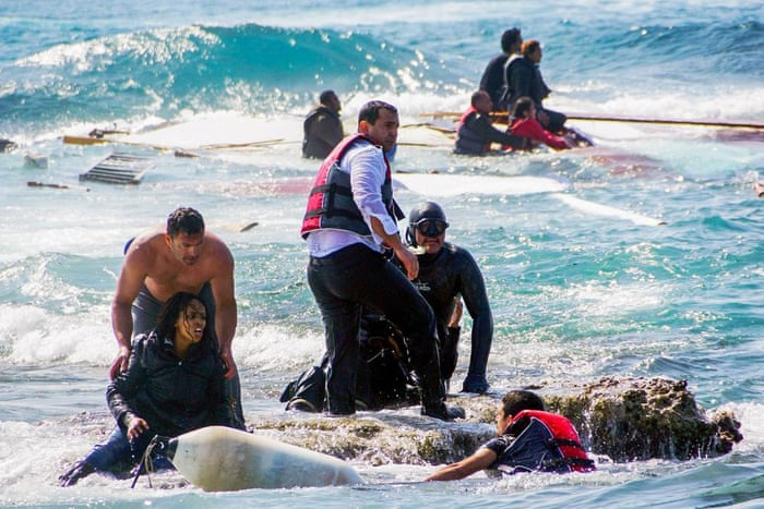 Migrants trying to reach Greece are rescued by members of the Greek coastguard and locals just off the island of Rhodes
