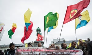Protesters in Brussels denounce attacks on Kurds in Turkey and Iraq.