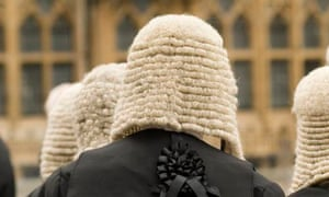 Viewing pornography on office computers was 'wholly unacceptable conduct for a judicial office-holder', the Judicial Conduct Investigations Office said.