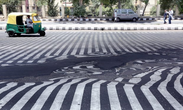 Road markings appear distorted during a heatwave in New Delhi, India, May 2015. Photograph: Harish Tyagi/EPA