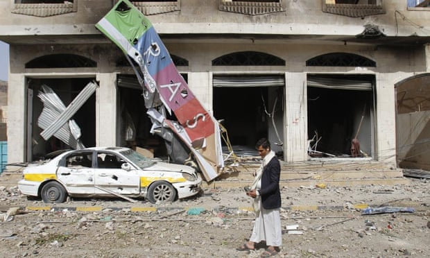A street is littered with debris after a Saudi-led air strike against Houthi rebels in Sana'a on Monday.