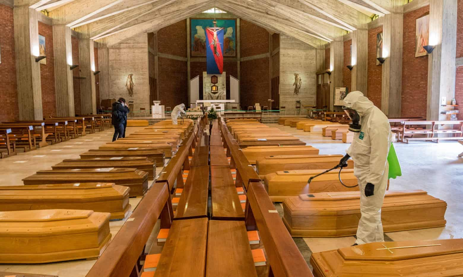 Army medical staff clears the coffins in the church of San Giuseppe in Seriate, Italy. Photograph: Carlo Cozzoli/REX/Shutterstock