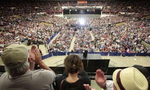 People cheer as Bernie Sanders speaks in the Veterans Memorial Coliseum.