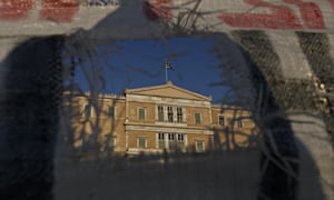 The Greek Parliament is seen during a protest in Athens last night.
