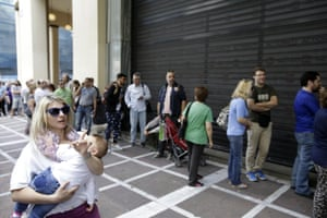 People stand in a queue outside a bank which operates on Saturday but eventually didn't open, in central Athens on June 27, 2015. Greece's fraught bailout talks with its creditors took a dramatic turn early Saturday, with the radical left government announcing a referendum in just over a week on the latest proposed deal - and urging voters to reject it. (AP Photo/Thanassis Stavrakis)