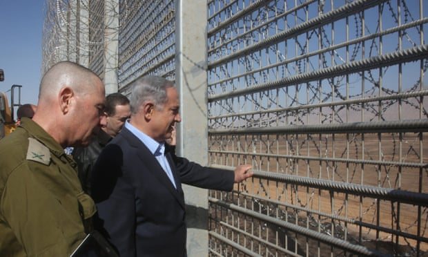 Binyamin Netanyahu inspects the new fence at the border between Jordan and Israel near Eilat, saying: 'In our neighbourhood, we need to protect ourselves from wild beasts.' Photograph: Marc Israel Sellem/Pool/EPA