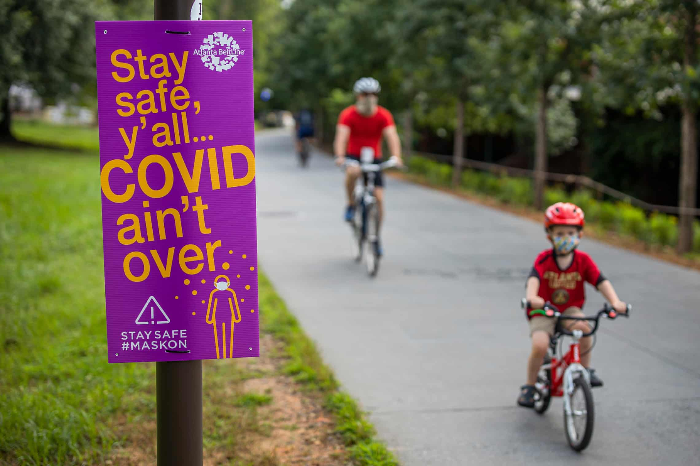 Safety information signs are seen along the Atlanta Beltline pedestrian and bike trail in Atlanta, Georgia. Photograph: Erik S Lesser/EPA