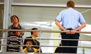 A woman and her children are apprehended by security at the Eurostar terminal.