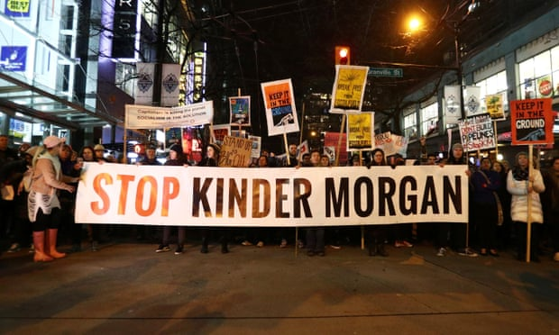 'Not on our watch': protesters in British Colombia march in opposition to Canada's decision to approve Kinder Morgan pipeline in the Alberta oil sands. Photograph: Ben Nelms/Reuters