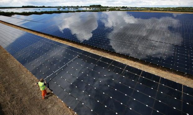 A workman cleans panels at Landmead solar farm near Abingdon, Oxfordshire. (Photograph: Peter Macdiarmid/Getty Images)