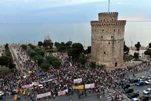 Supporters of the NO vote in the upcoming referendum gather near the White Tower, the city's landmark, in Thessaloniki on June 29, 2015. The ballot has been drawn up and a 'Vote No' poster designed: Greek Prime Minister Alexis Tsipras's government has lost no time in preparing for the country's hotly-anticipated bailout referendum. AFP PHOTO / SAKIS MITROLIDISSAKIS MITROLIDIS/AFP/Getty Images