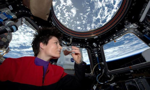 Italian astronaut Samantha Cristoforetti sips espresso from a cup designed for use in zero-gravity, on the International Space Station
