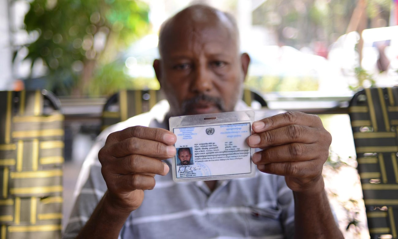 Somali refugee Abdulkadir Dahir Muse, 55, holding his UNHCR refugee card in Phnom Penh. He arrived in Cambodia in 2001 and received his refugee status card in 2002. He has lived in Cambodia ever since, but says he wants to leave.