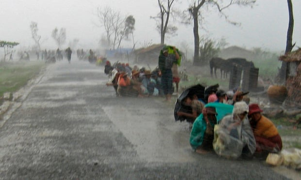 Cyclone victims in Myanmar huddle in torrential rain as they await assistance after Cyclone Nargis in May 2008, the worst mega-disaster of the past decade. (Photograph: Reuters)
