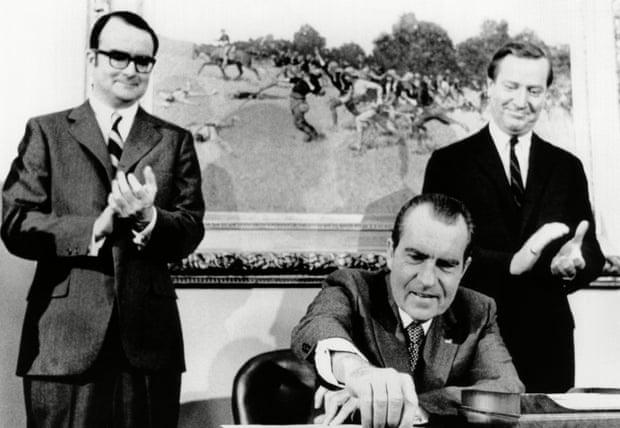 William Ruckelshaus (left) applauds as Richard Nixon signs far reaching anti-pollution legislation in 1970. (Photograph: Everett/Rex Shutterstock)