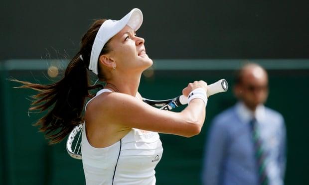 Agnieszka Radwanska hits the ball into the air after winning her match.