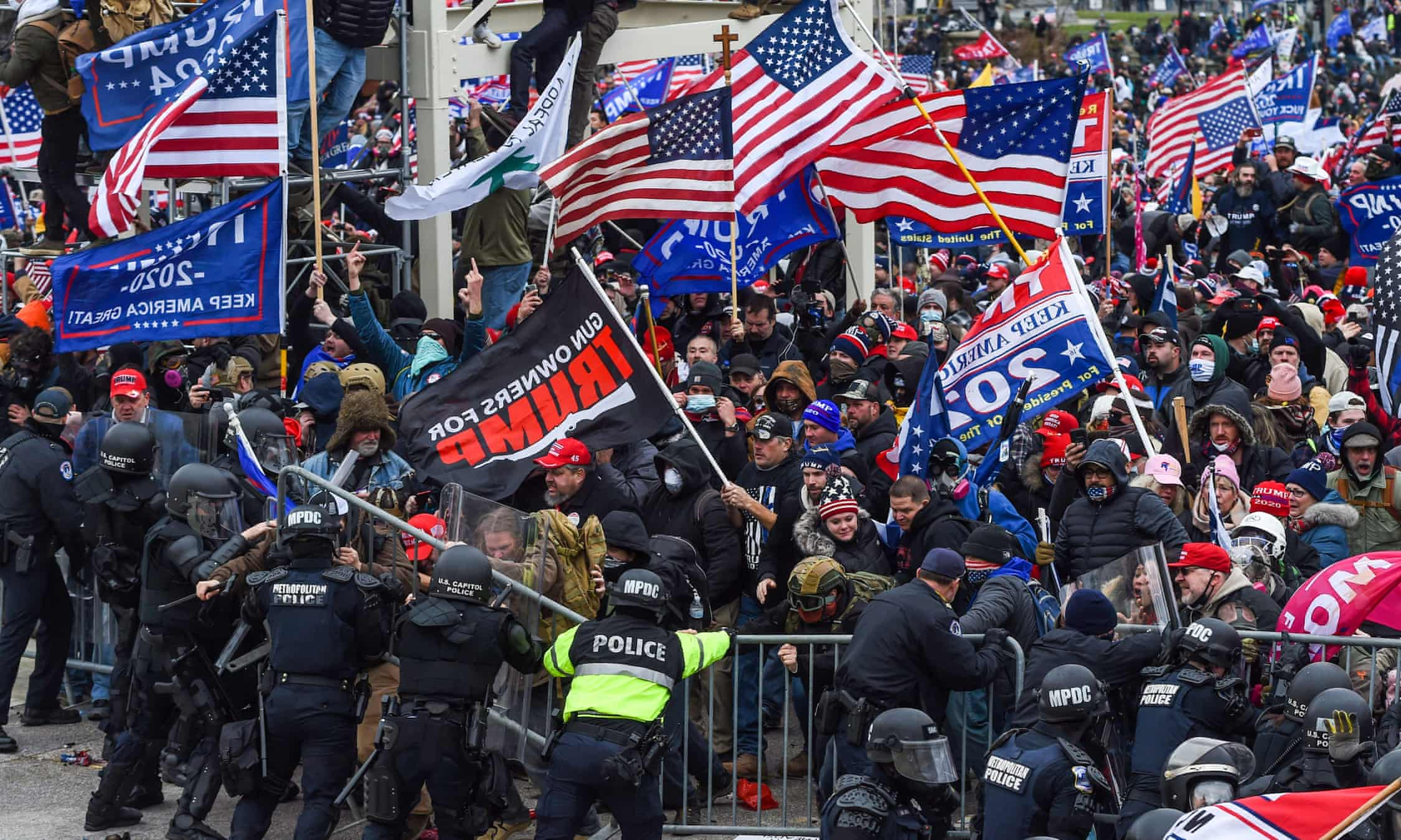 Trump supporters clash with police and security forces as they storm the US Capitol in Washington DC on 6 January 2021. Photograph: Roberto Schmidt/AFP/Getty Images