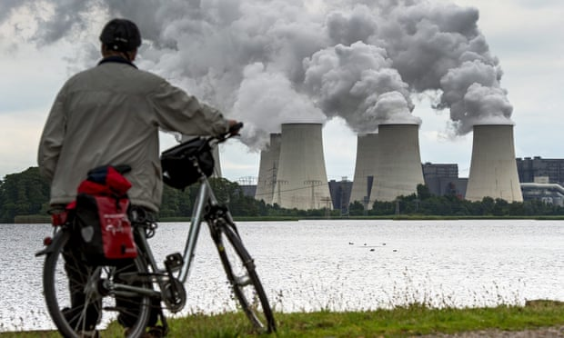 Water steam rises from the cooling towers of a brown coal power station in Germany. Such plants with a total capacity of 2.7GW will be mothballed. Photograph: Patrick Pleul/EPA