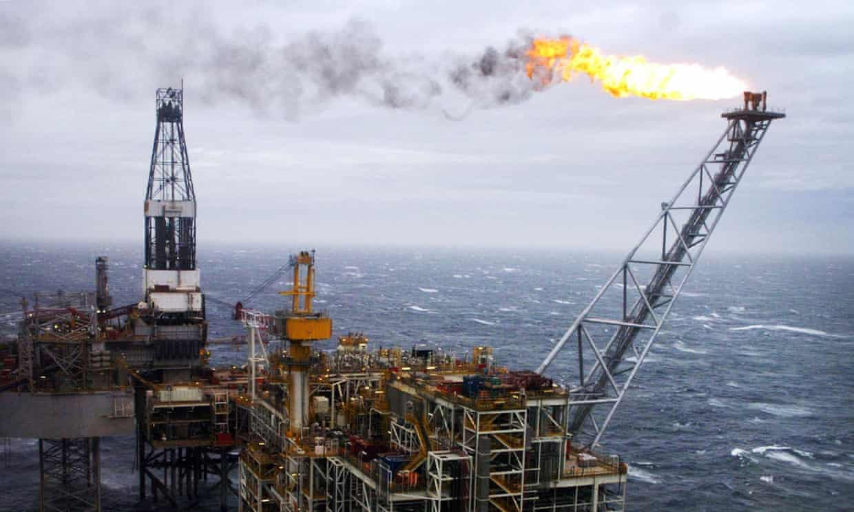 An oil rig in the North Sea 'flaring', a practice that led to 3m tonnes of carbon being emitted into the atmosphere last year from UK rigs. Photograph: Danny Lawson/PA