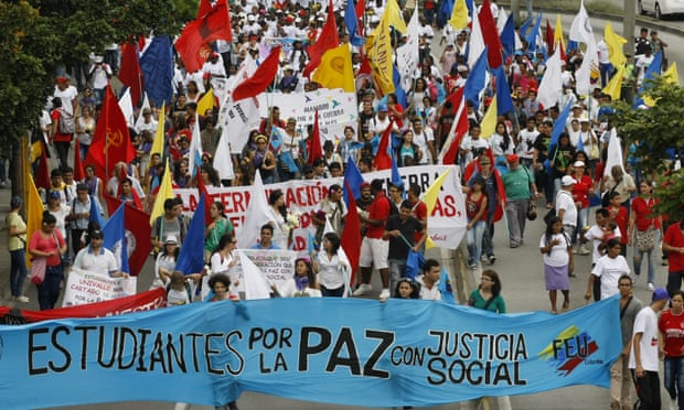 Hundreds of people march during an event to support 'yes' in the referendum promoted by the government to ratify peace agreements with the Farc, in Cali, Colombia. Photograph: Christian Escobar Mora/EPA