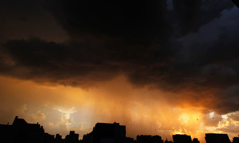 A storm approaches Buenos Aires. Photograph: Marcos Brindicci/Reuters