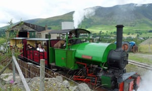 A steam locomotive sets out on a journey up the narrow gauge railway at Threlkeld Quarry and Mining Museum.