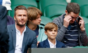 David Beckham with his son Romeo at Centre Court at Wimbledon.