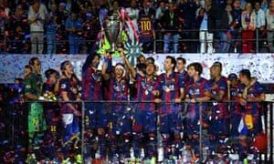 Neymar lifts the trophy as he celebrates victory.
