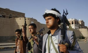Shia Houthi rebels march through Sana'a to protest against Saudi-led air strikes.