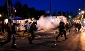 Riot police use teargas outside the Greek parliament