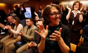 Members of the audience react after the Federal Communications Commission votes to pass the new rules.