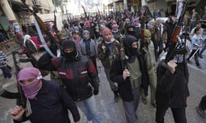 Syrian rebels march in a show of strength during a demonstration in Idlib, Syria.