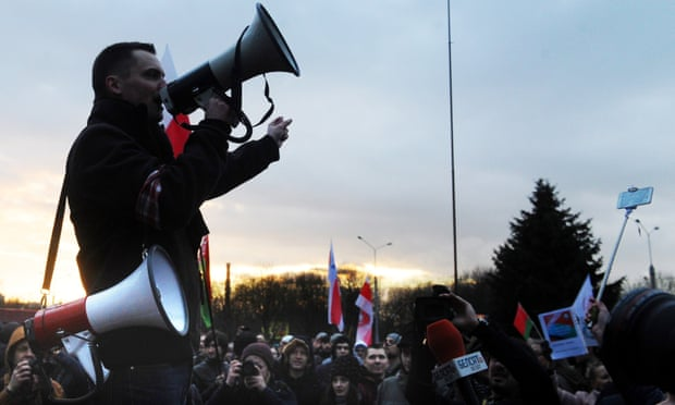 A demonstrator at 'The March by Those Who Are Not Social Parasites' in Minsk last week. Photograph: Viktor Drachev/Tass