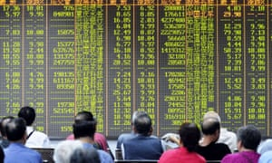 Investors sit in front of a screen showing market movements in a stock firm in Hangzhou, eastern China's Zhejiang province on July 8, 2015.