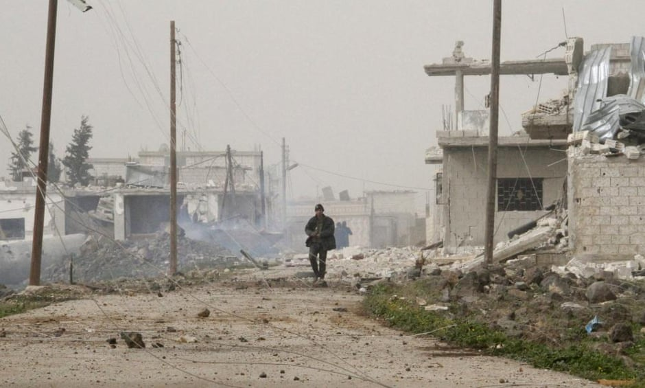 Syrian government forces walk in Deir al-Adas in the Daraa province.