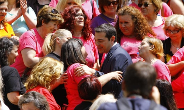 Prime Minister Alexis Tsipras hugs finance ministry cleaners who were laid-off in 2013 but rehired on Thursday.